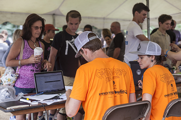 Dad, Mike Girard, and staff taking care of riders at registration. Photo: Khaleeq.
