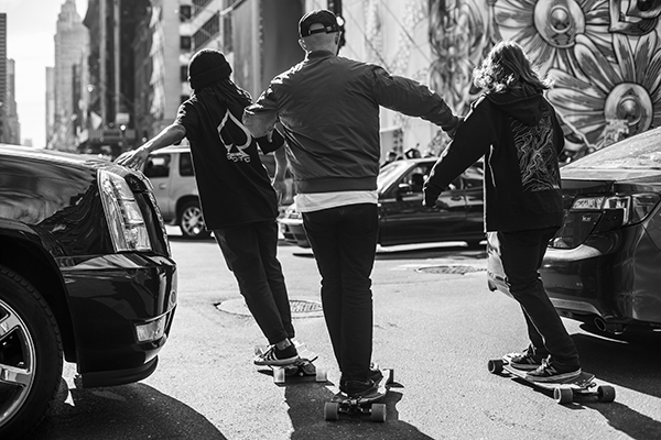 NYC locals Leon, Victor, and David making it through the first set of cars and looking before pushing into the next lane. Photo: Khaleeq.